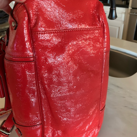 Juicy Couture Handbags - Juicy Couture patent red leather clutch handbag